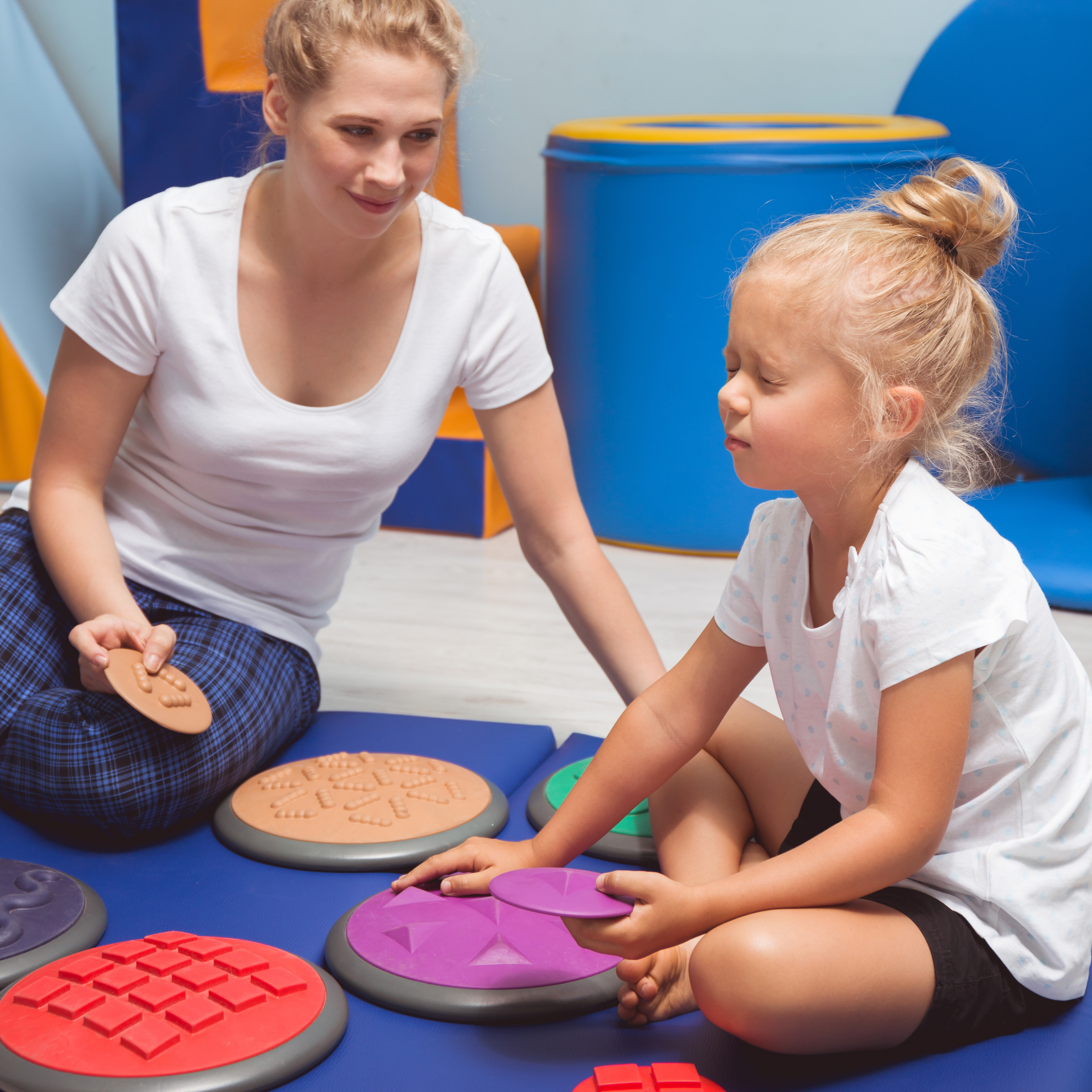 child using sensory boards for play